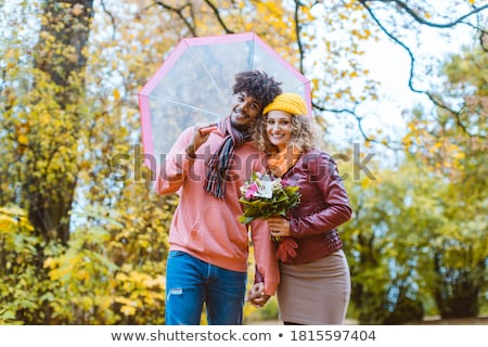 Man and woman of different ethnicity hugging in fall Stock photo © Kzenon