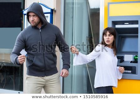 Ladro rubare carta donna piedi contanti Foto d'archivio © AndreyPopov