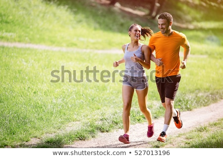 Couple jogging in forest stock photo © lichtmeister