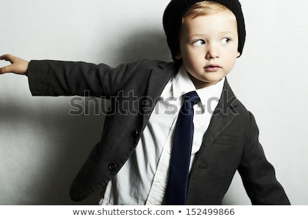 Baby boy with grey cap looking up. Stock photo © lichtmeister