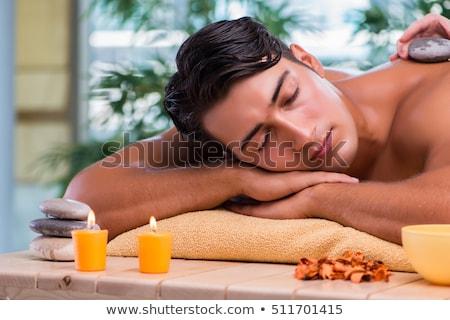 Fiatal jóképű férfi fürdő eljárás virág orvos Stock fotó © Elnur