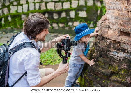 Man videographer and his son shoots video in the electronic stabilizer, steadycam To shoot at Po Nag Stock photo © galitskaya