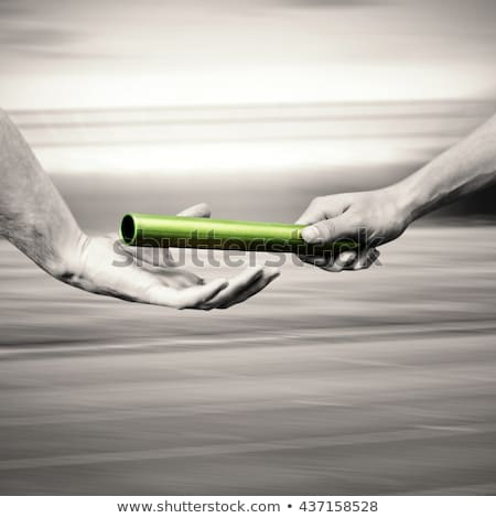 Man Passing The Baton To Partner Stock photo © AndreyPopov