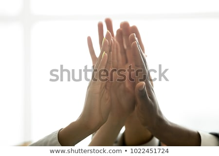High view of happy African American family holding hands and praying together at dining table in a c Stock photo © wavebreak_media