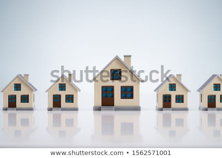 Small House Models Arranged In Row Over Table Stock photo © AndreyPopov