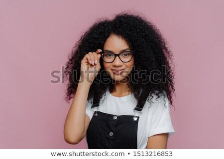 Bastante africano americano mulher mão quadro óculos Foto stock © vkstudio