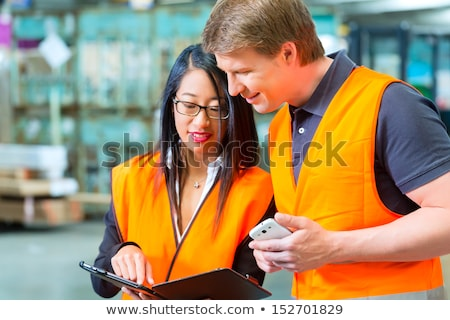 Worker woman in a logistics company with a tablet computer Stock photo © Kzenon