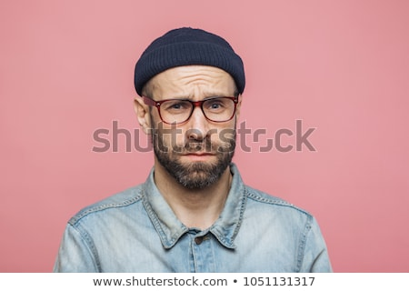Grumpy bearded man with offended expression, being dissatisfied with something, frowns face, wears s Stock photo © vkstudio