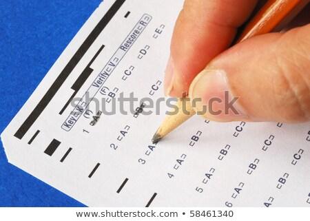 fill the computer grade sheet isolated on blue stock photo © johnkwan