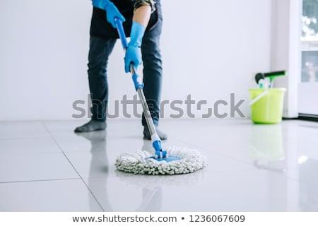 Jovem governanta lavagem limpeza piso luvas Foto stock © snowing