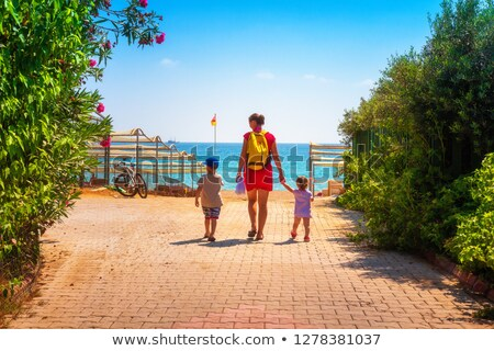 Mother with daughter go on sand Stock photo © Paha_L