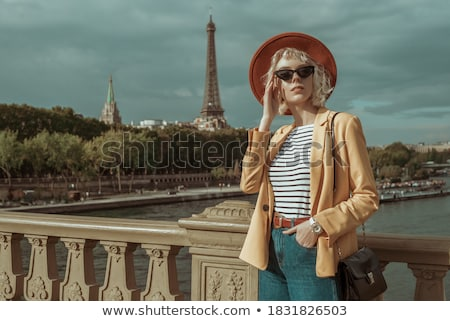 Red girl in striped black-yellow hat Stock photo © Paha_L