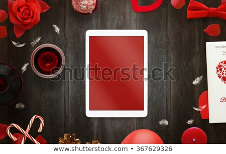 Red rose petals on books and bottle of wine. Stock photo © inaquim