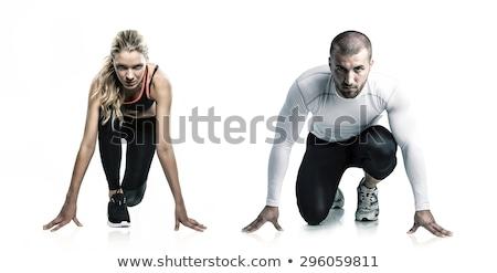 female athlete ready to run isolated on a white background stock photo © nobilior