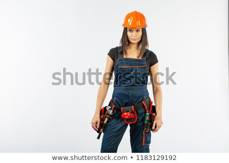 Portrait of a girl with helmet and overall Stock photo © photography33