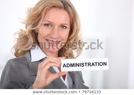 Smart woman holding a sign entitled 'ADMINISTRATION' Stock photo © photography33