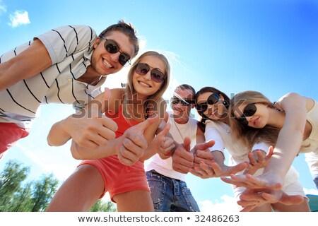 közelkép · mosolyog · fiatalok · szórakozás · tengerpart · mosoly - stock fotó © photography33