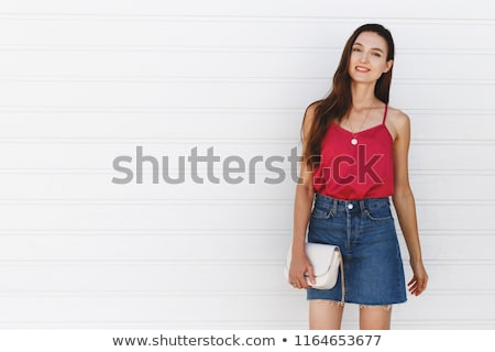 standing woman wearing blue clothes with handbag Stock photo © phbcz