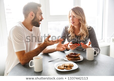 Stock photo: Man Talking With His Wife On The Phone