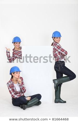 female trio wearing blue hard hat looking joyful Stock photo © photography33