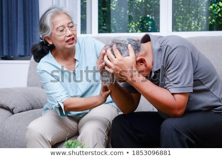 Man stroking his wife's head Stock photo © photography33