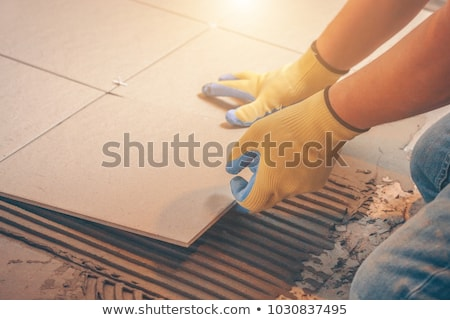 Man laying out tiles on the floor Stock photo © photography33