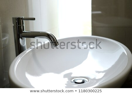 Washbasin made of ceramic or porcelain on white background  Stock photo © JohnKasawa