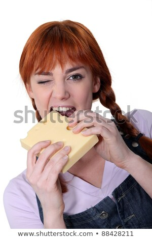 Woman biting into block of cheese Stock photo © photography33