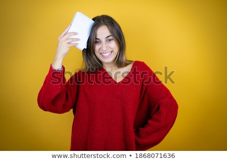 Girl in green sweater holding blank yellow sign stock photo © jarenwicklund