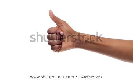 thumbs up on a black background Stock photo © photochecker