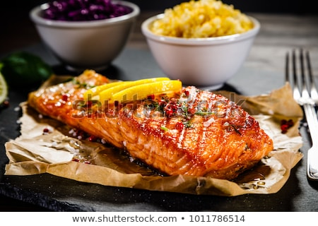 Meat and fish dishes with vegetables on the table. Stock photo © borysshevchuk