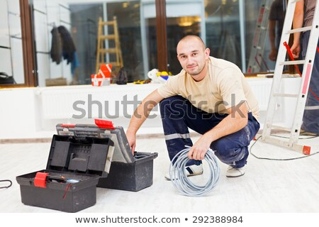 Handy Man Working With Cables Stock photo © Lighthunter