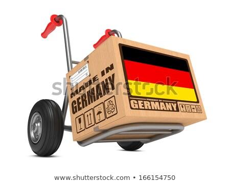 Made in Germany - Cardboard Box on Hand Truck. Stock photo © tashatuvango