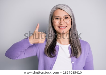 Female hand showing thumbs up sign isolated on white Stock photo © bloodua