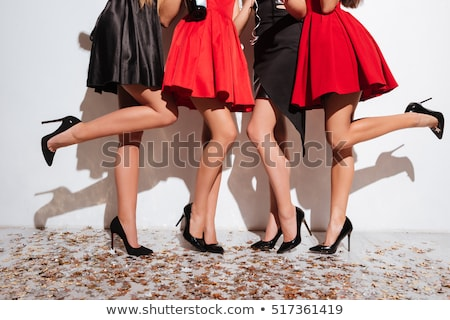 Közelkép kép női lábak fekete sarkak Stock fotó © deandrobot