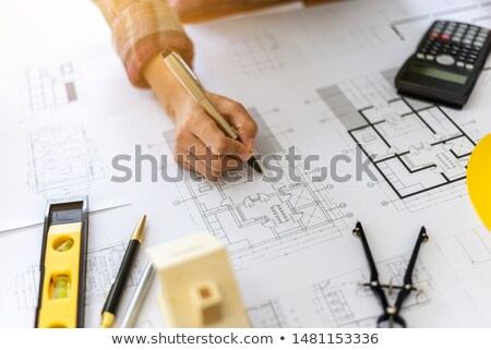 Női építész tervrajzok izolált fehér jpg Stock fotó © Voysla