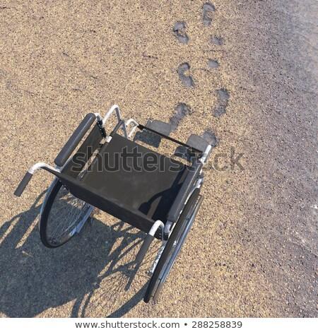 üres tolószék tengerparti homok lábnyomok technológia egészség Stock fotó © denisgo