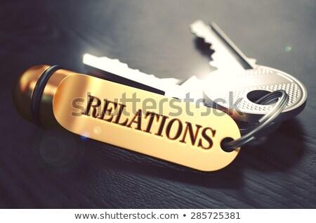 Relations - Bunch of Keys with Text on Golden Keychain. Stock photo © tashatuvango