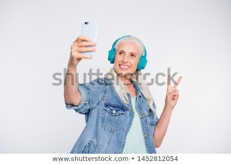 woman showing peace sign stock photo © imagedb