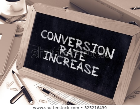 Conversion Rate Increase - Chalkboard with Hand Drawn Text. Stock photo © tashatuvango