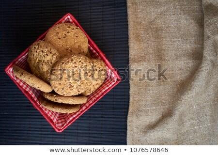 Oatmeal Raisin Cookies on a  burlap background. Stock photo © rojoimages