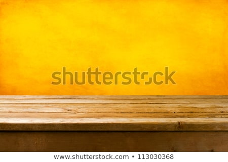 Background texture with old wooden table and yellow autumnal lea Stock photo © teerawit