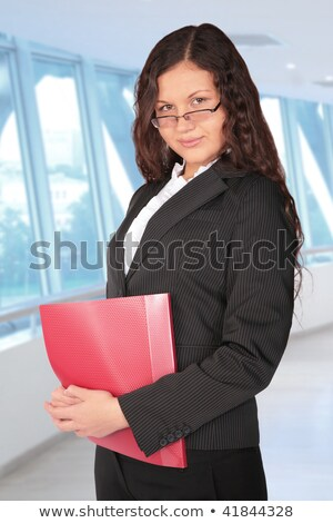 beautiful brown-haired woman with red folder in the hall of biss Stock photo © Paha_L