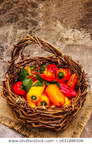 Fresh juicy red sweet pepper close up on a stone background Stock photo © mcherevan