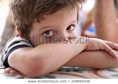 Fiú barna haj néz elégedetlen kéz gyerekek Stock fotó © meinzahn