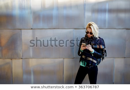 Woman using smartphone on the street facing the wall Stock photo © stevanovicigor