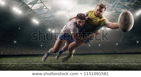 Rugby player tackling the opponent Stock photo © wavebreak_media