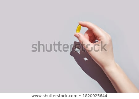 Two medicinal capsules Stock photo © bluering
