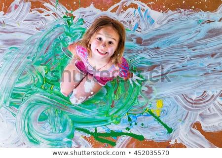 happy little girl artist with her art supplies stock photo © ozgur