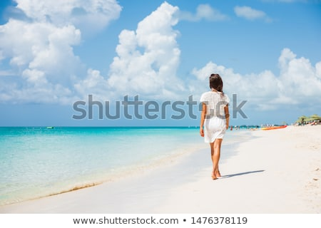 woman in white dress walking on beach stock photo © simply